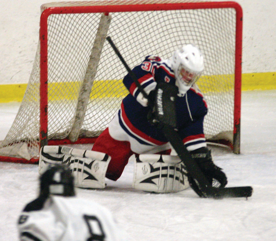 Toll Gate goalie David Stachurski stops a low shot.