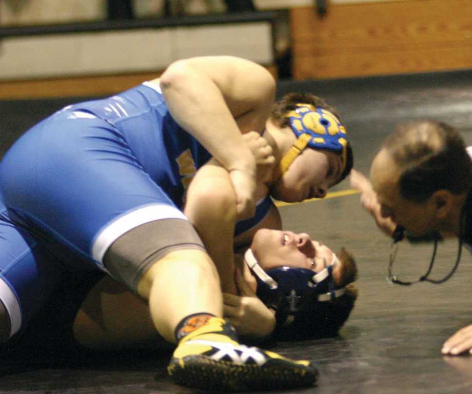 COMING UP BIG: Vets' Aaron Hurst gets a pin on Pilgrim's Mike Pereira in a key match.