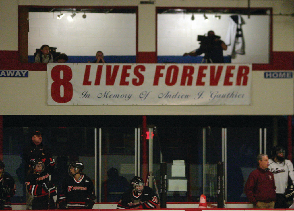 The La Salle and Hingham girls' teams play the Hap Mathews game under the banner honoring Andrew Gauthier.
