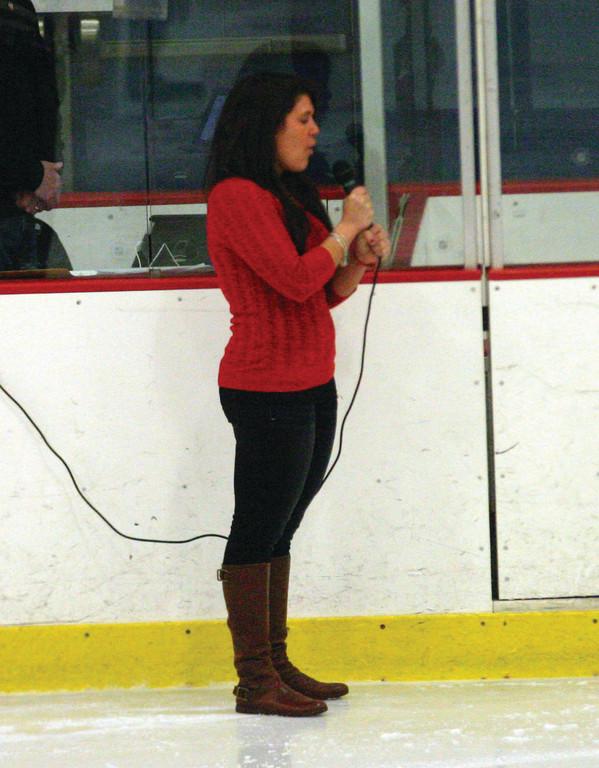Lindsay Iadeluca sings the national anthem.
