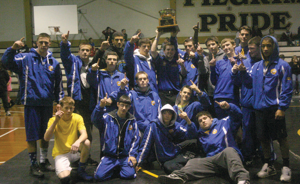 WARWICK'S BEST: The Vets wrestling team poses with the trophy after winning the city championship on Monday afternoon at Pilgrim. The 'Canes topped Toll Gate and Pilgrim for their seventh consecutive city crown.