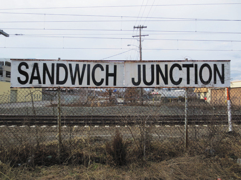 Look for this familiar sign, overlooking the tracks and visible as you travel down Kilvert Street - heading straight for the home cookin' of Sandwich Junction.