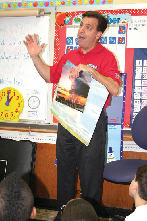 LIGHTNING STORM SAFETY: Tony Petrarca of Channel 12 visits the second grade students at Arlington Elementary School. He spoke about various weather patterns and emphasized safety during lightning storms.