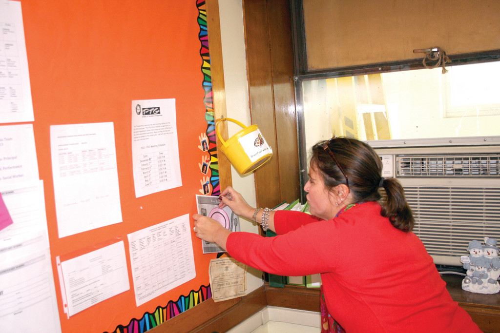 BREAKFAST WITH THE PRINCIPAL: Principal Susan Buonanno checks her basket at Gladstone School to see whose classroom she will be visiting during the Breakfast in the Classroom program in the upcoming weeks.