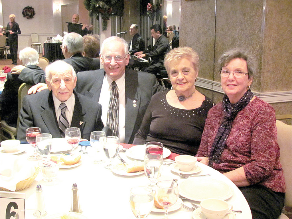 Leonard DiLeone (left) was honored for his 97th birthday at the Inauguration Dinner/Dance. He is joined by his son Kenneth DiLeone and his wife Gloria DiLeone, and his companion of 14 years, Lola Marrocco.