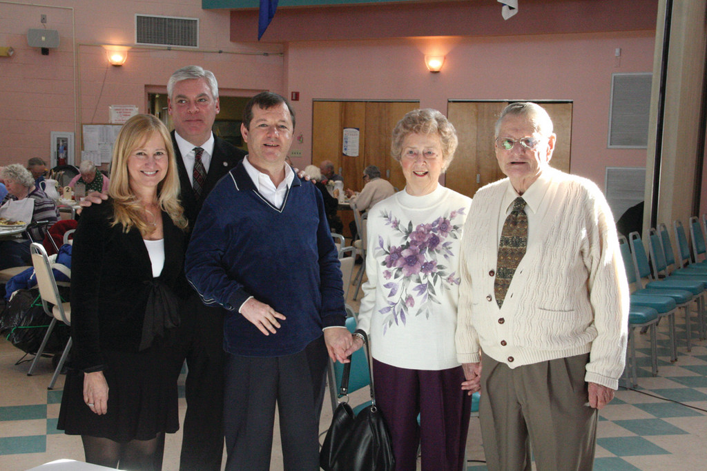 Pilgrim Senior Center Director Meg Underwood and Mayor Scott Avedisian celebrated Steve Englert's 30 years of city employment Tuesday. Joining Steve for the picture are his parents, Evelyn and Walter.