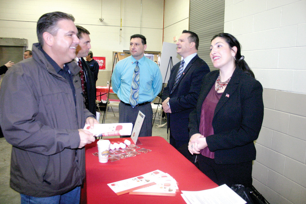 "SOLDIER CERTIFIED: At least 75 attended Tuesday's ""Hiring Our Heroes,"" a job fair for military members and veterans. Among them was Army veteran David Lowe of Pawtucket, who chats with Diana Saccoccio, assessment advisor for the CAM Group, which operates under the umbrella of CVS Caremark, a co-sponsor of the event."