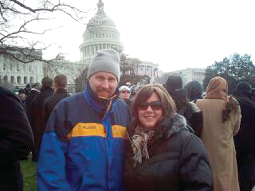 SO CLOSE: Nicole Egan and her boyfriend, Doug Prescott, wait on the Capitol green for the 2013 Presidential Inauguration to commence. Not pictured are Egan's daughters, Alexandara and MacKenzie, and Doug's daughter, MacKenzie, who joined Egan and Prescott at the inauguration.