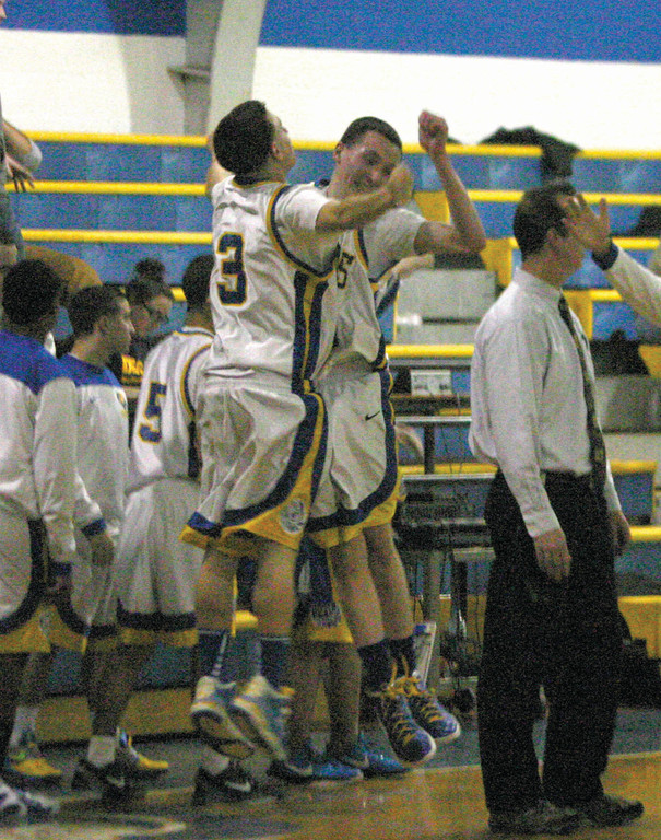 BIG WIN: Vets' Kyle Agin, left, and Kyle Rice bump chests to celebrate the 'Canes' come-from-behind victory over Scituate on Tuesday. Vets rebounded from a 14-point deficit to get the win.