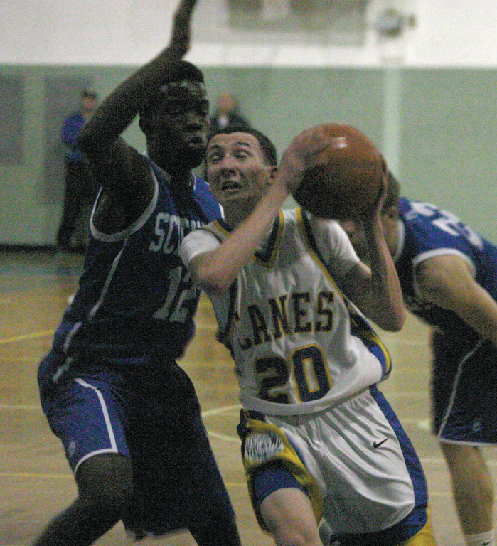 Kyle Rice drives to the basket against Collins Omollo.