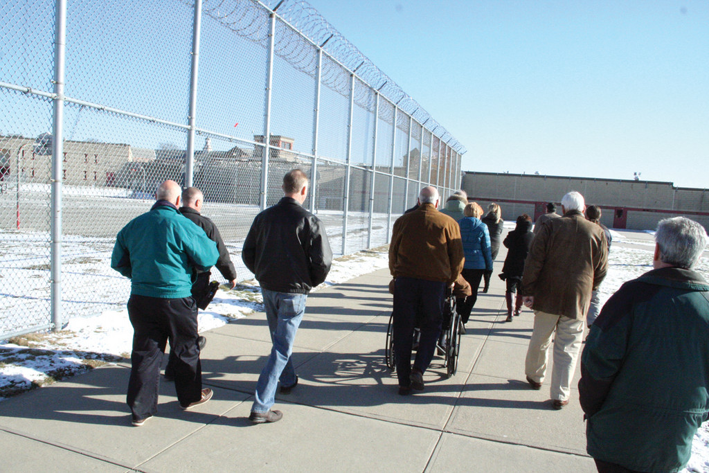 IT WAS COLD: Members of the Rotary Club of Warwick cross the medium security yard during a tour of the facility on Thursday.