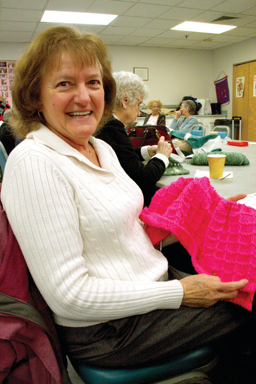 BY FEEL: Ginger Stapleton, who is legally blind, prefers knitting blankets.