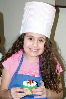 CHEF WITH A CAUSE: Instead of asking for presents for her birthday, Caitlyn Lefebvre, 9, requested her friends make contributions to a foundation that aids Haiti. Caitlyn and her friends raised $150 for the cause at her party on Saturday, which was held at Petite Chef.