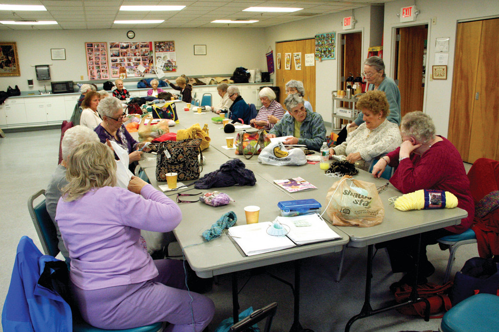 NEARLY A FULL TABLE: The Knit Witters that numbered eight when they started now has more than 30 regulars.