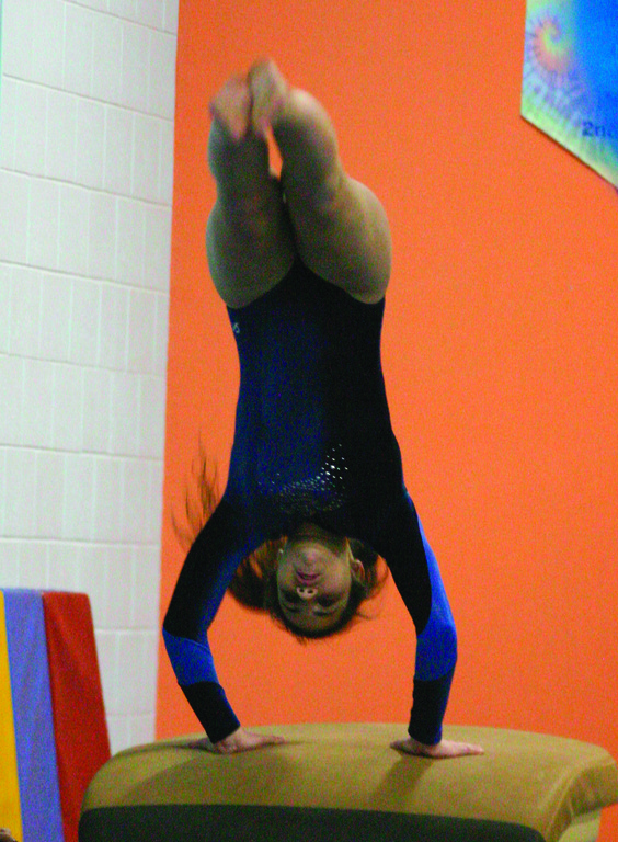 Eren Oztunc does a flip on the vault.