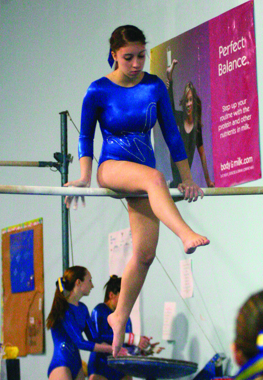 BALANCED: Vets' Nicole Nehiley competes on the uneven bars during Sunday's meet.