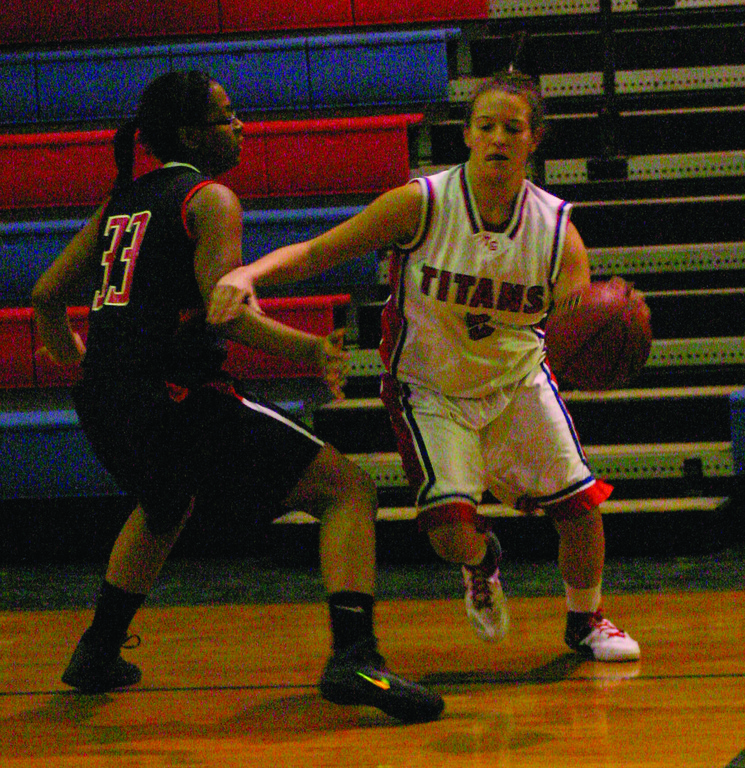 DRIVING: Amanda Iadevaia makes a move on the baseline.