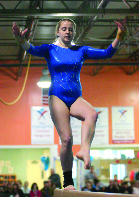 Kayleigh Desjarlais does her routine on the balance beam.