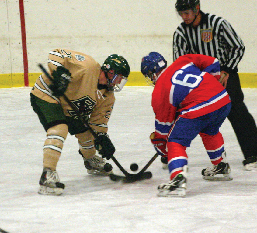 BATTLING: Hendricken's Ed Markowski and Mount's Patrick Holmes fight for the puck on a face-off in Saturday's game. Mount won 3-1 over the previously unbeaten Hawks.