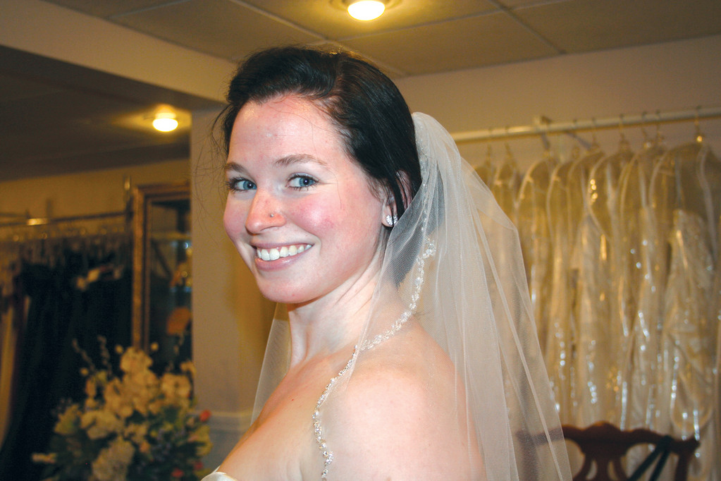 SAY YES TO THE DRESS: Warwick resident Caitlin Shalvey shows off her veil at a dress fitting at The Bridal Shoppe on Warwick Avenue. Shalvey's dress couldn't be photographed, as her wedding to fiancé Dana Traversie will not take place until March.