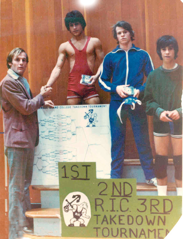 Back in 1976, Anthony Joseph Casali (left) wrestled at 112 pounds and won the RIC Takedown Tournament. He's congratulated by former Anchorman coach Rusty Carlsten and joined on the victory stand by runner-up Kenny Tougue of Hope and Mike Sanchez of Bristol.