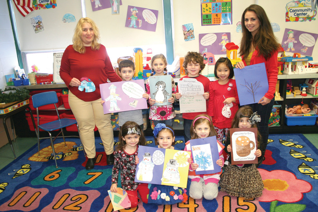 The all-day Pre-K students show off some of the many projects they have created so far this winter, which tie together a wide variety of curriculum areas and developmental skills.
