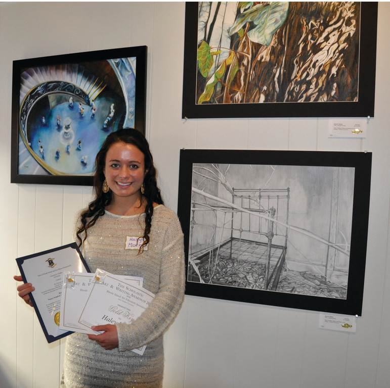 MULTIPLE WINNER: Haley Moen is the winner of the Governor Chafee Portfolio Citation for Best of Show and two gold keys in the 2013 Rhode Island Art Educators Association Scholastic Art and Writing Awards. She is pictured here at the awards ceremony in Newport.
