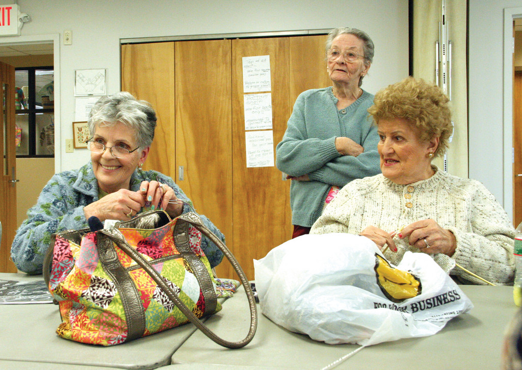 SHE STARTED IT ALL: Barbara Daniels, at center, talks with Marie Baguchinsky and Dorothy Antonson from Providence. Daniels started the knitting group 15 years ago.