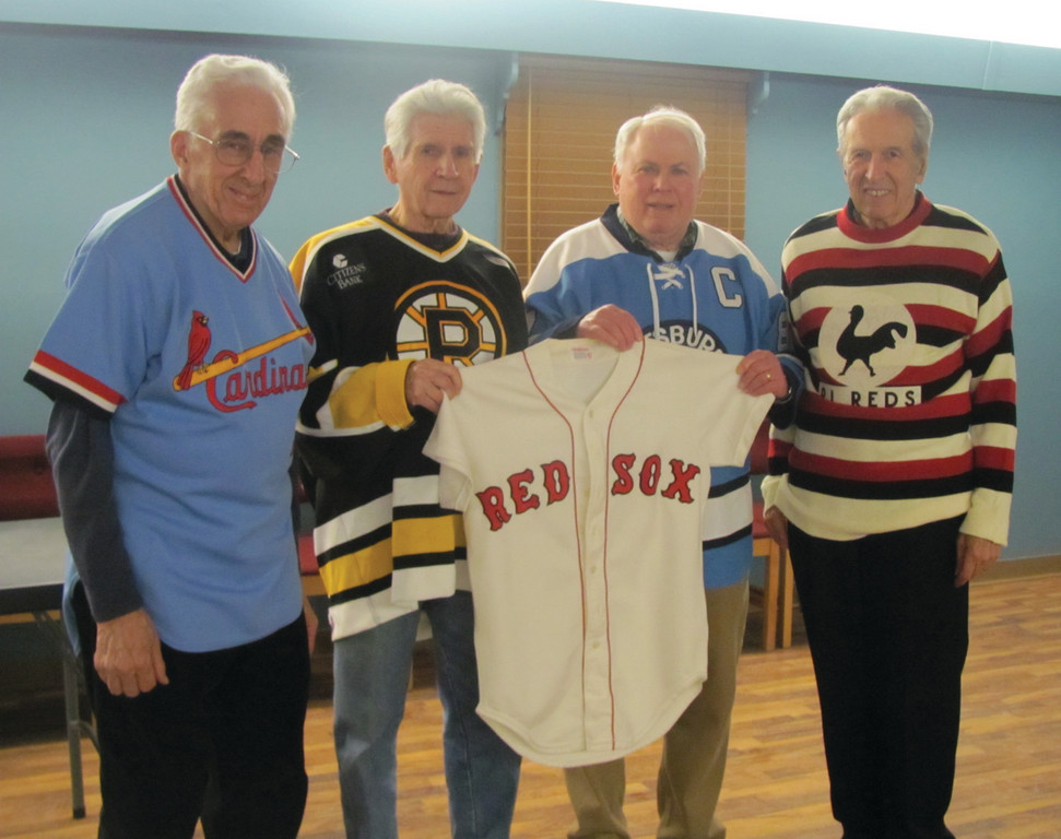 INTERESTING ITEM: St. Joseph Men's guild members Joe Shekerow (second left) and John Murphy (third left) hold a Boston Red Sox jersey that will be a hot item at Saturday's 37th annual Cranston Sports Collectors Show. They're joined by Guild members Richard Santa Maria and Ralph Almonte.