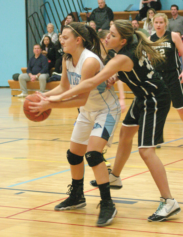 Janelle Paliotte plays defense in the post.