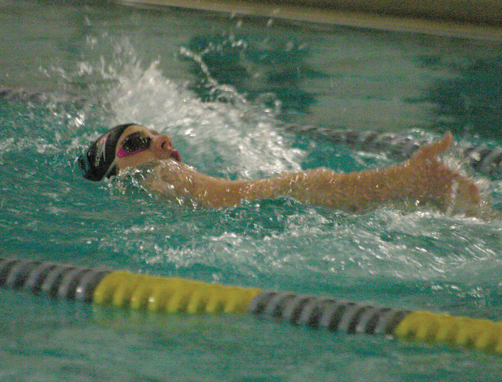 UNDER WATER: Nick Tomasso competes in the backstroke during Tuesday's meet with Barrington.