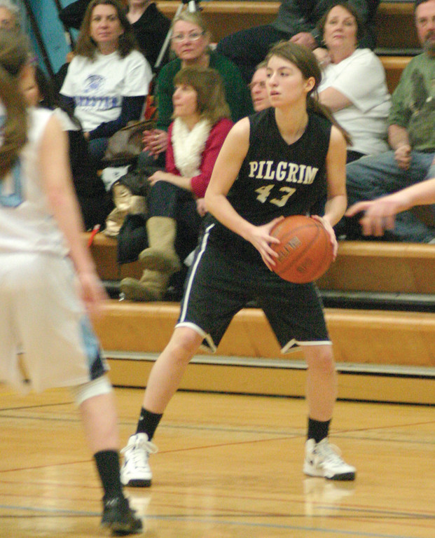 LOOKING: Pilgrim's Alexa Annotti passes the ball around the perimeter in Tuesday's game.