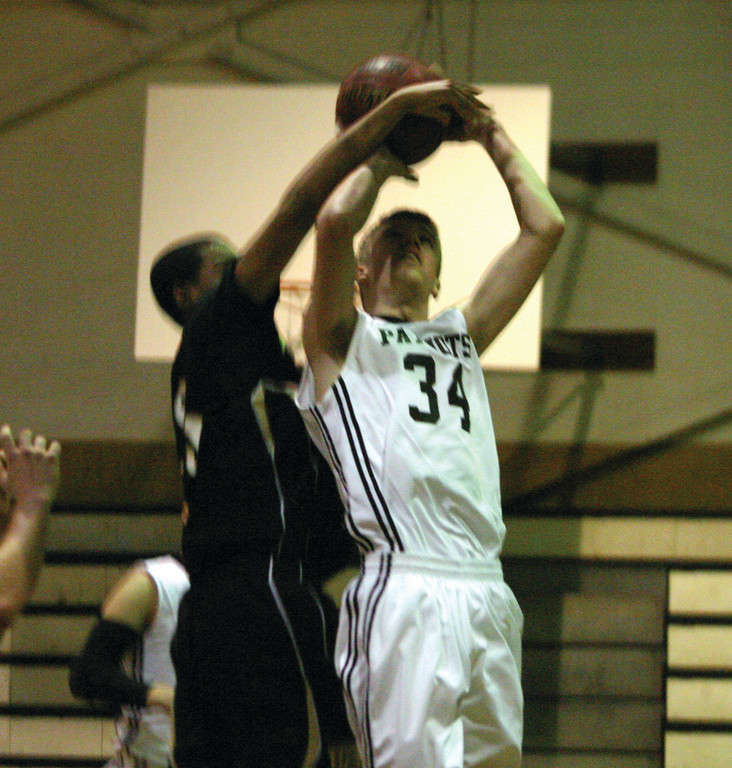 Brendan Rix gets fouled under the basket