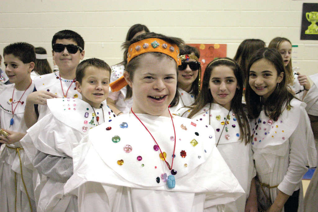 HAPPY STUDENTS: Sixth grader Joey Egan gives a big smile after the performance.