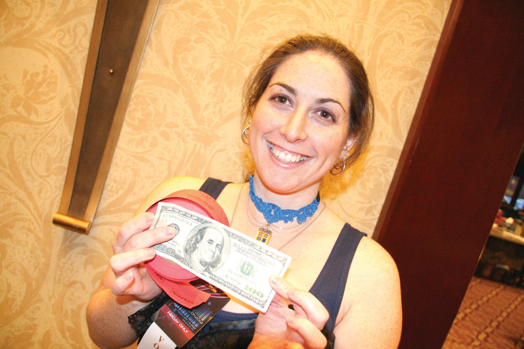 WHAT GOOD FORTUNE: Rose Blaney shows off the $100 bill she was handed by a TempleCon attendee who wanted to help support the RI Community Food Bank.