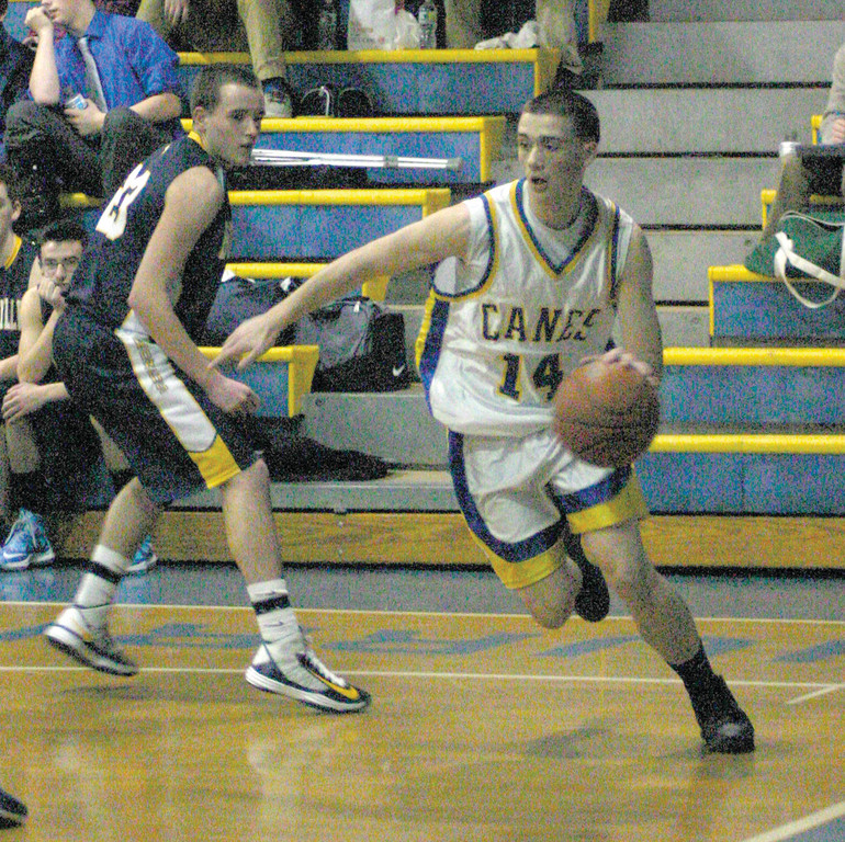 GOING BASELINE: Vets' Ill Remak drives to the hoop in Friday's game.
