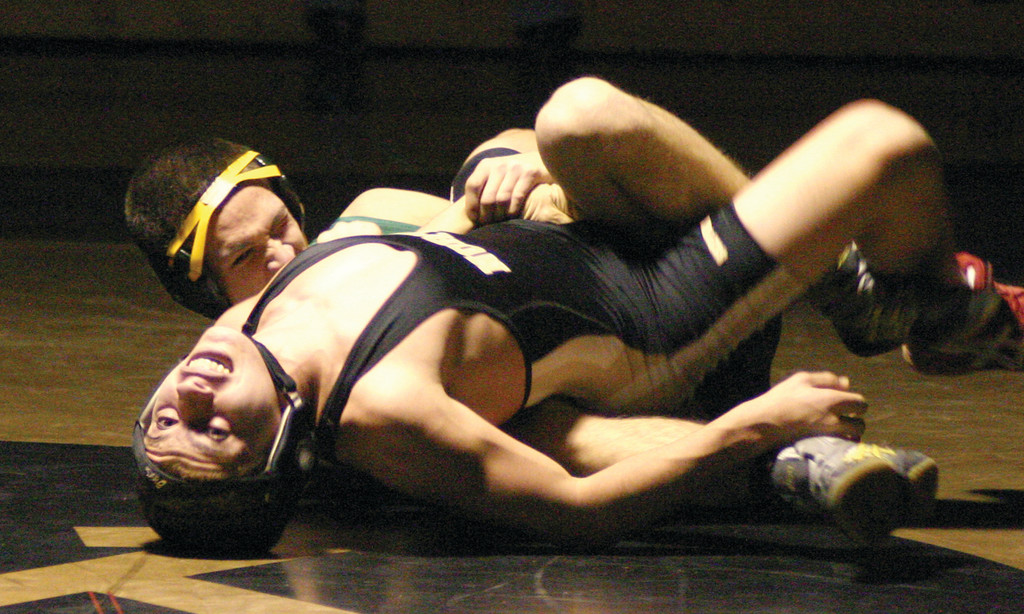 TAKING CHARGE: Hendricken's John Arruda gets a hold on his opponent at 138 pounds on Thursday.