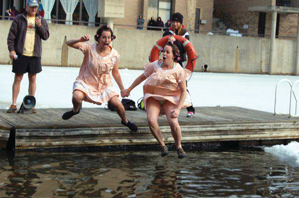 LEAPIN' FOR A REASON: Christina and Becky jump into the chilly waters at Reston, Va. during the 2010 Polar Dip.
