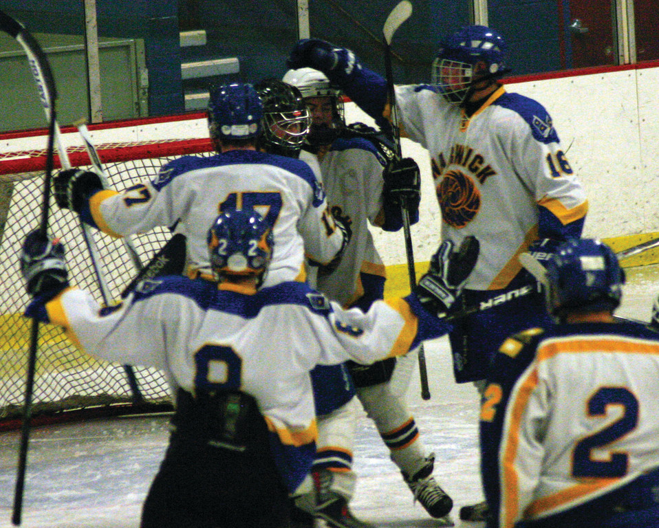 VICTORY: Vets players celebrate with goalie Alec Silvestri after their first victory of the season on Friday.