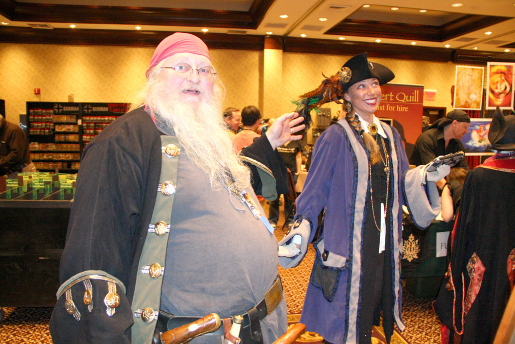 SHE'S HIS KIND OF LADY: Don Taylor, who markets pirate costumes among other attire, believes Sarah Cotrupe of Utica, N.Y. has found just what becomes her. There were about 50 vendors at TempleCon.