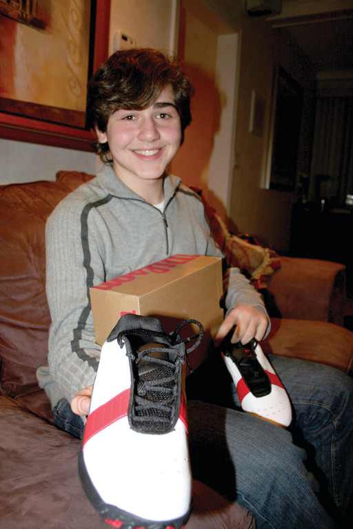 WALK IN MY SHOES: Cranston resident Nicholas Lowinger is one of 30 teenagers worldwide selected for the Global Teen Leaders program. Now 15, Lowinger is the CEO and founder of the Gotta Have Sole Foundation, which distributes new shoes to homeless young people.