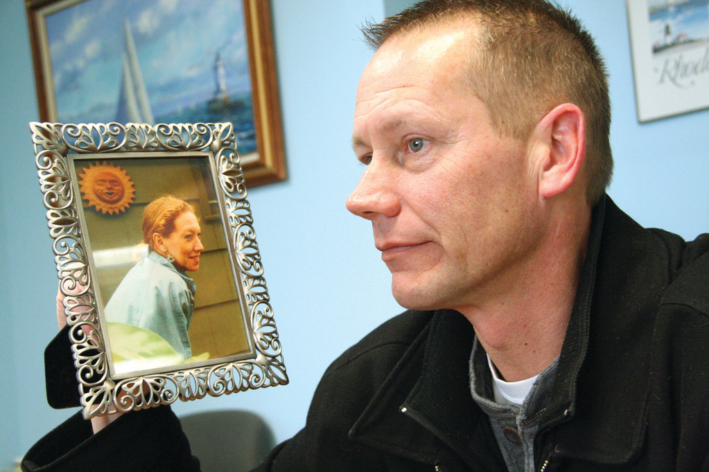 LOST TO GUNMAN: James Tyrell with a picture of his sister Debby, who was killed on Jan. 30, 2004.
