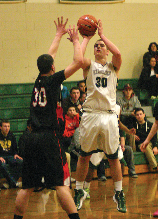 PULLING UP: Hendricken's Ryan Hagerty takes a jumper in front of Cranston West's Mike Rainone during Tuesday's game.