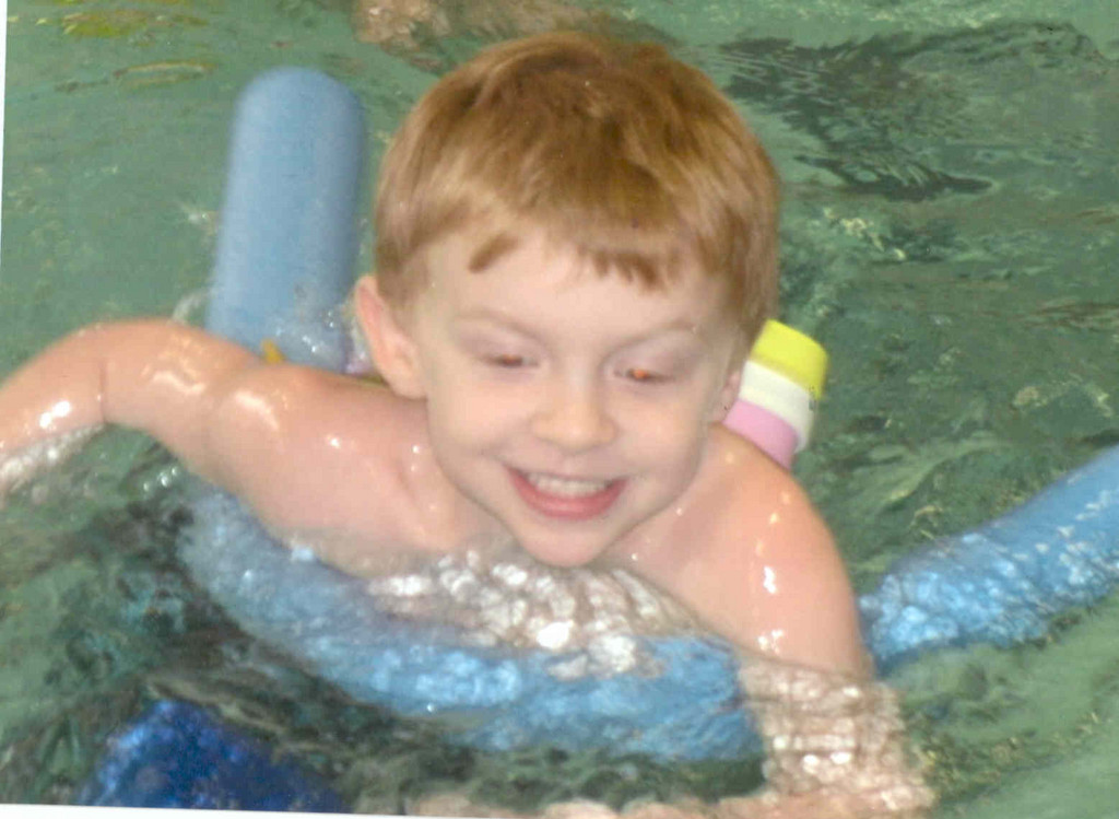 """Y'S"" LITTLE OWL: Cranston resident and student of the Kent County YMCA ""Y's Owl Nursery School,"" Charlie Paley, 5, enjoys a swim in the pool. He's been attending the school since he was 1."