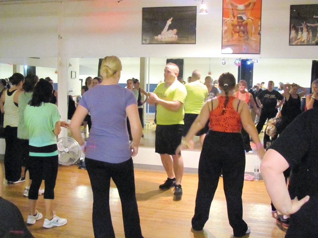 Richard Marchetti, a Johnston native who teaches Zumba three days a week, does some high-energy dance exercises during his hour-long class.
