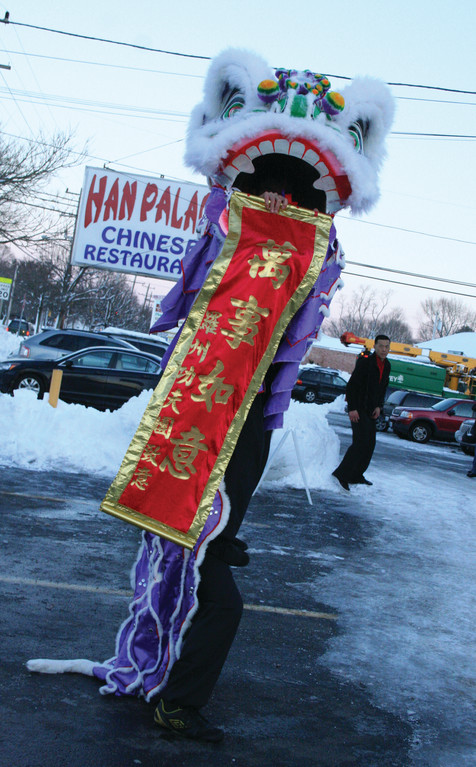 HAPPY NEW YEAR! To kick off the Chinese New Year, the owners of Han Palace invited the Rhode Island Kung Fu Club to perform a traditional lion dance at their restaurant Sunday evening. They began the performance in the parking lot and eventually danced their way inside.