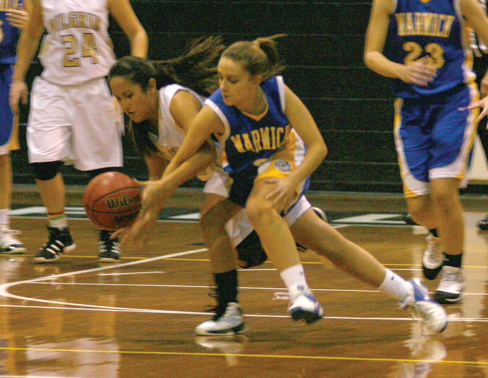 Pilgrim's Claire Birney and Vets' Victoria Flynn battle for a loose ball during Thursday's game. Pilgrim beat Vets for the first time in three tries this year.