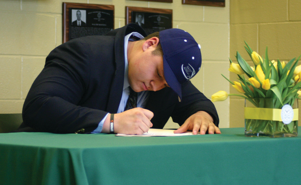 MAKING IT OFFICIAL: Hendricken lineman Nick DeCiantis will continue his football career at St. Anselm.