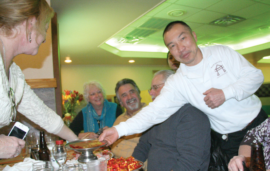 SERVE IT UP: Keith Lau, one of the restaurant's co-owners, serves food to guests.