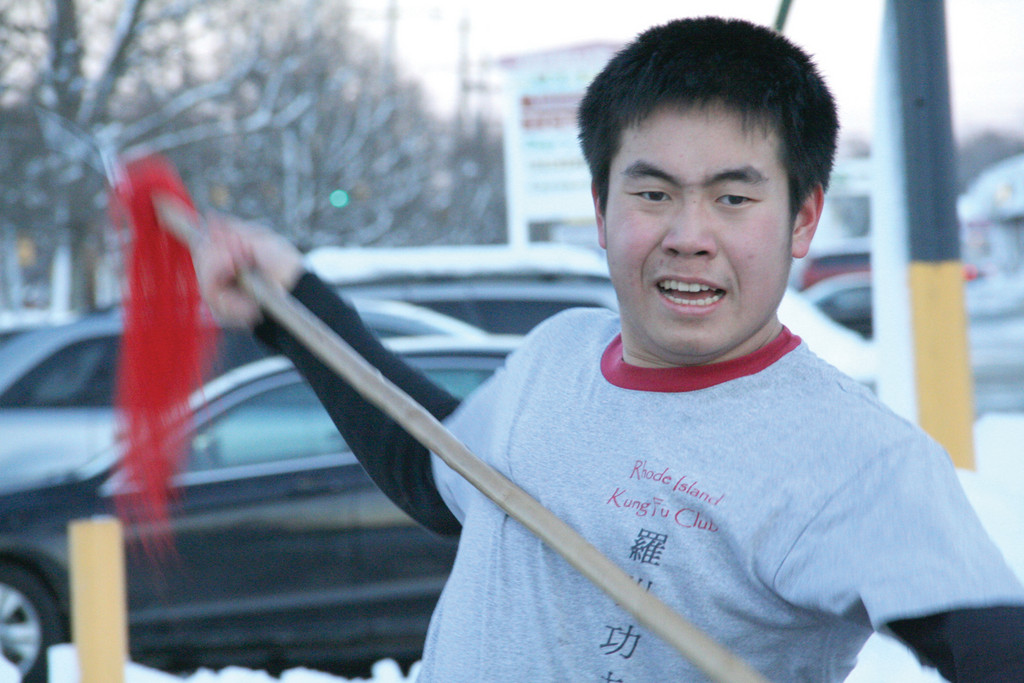 HOLD THE COLD: Despite the snow, a member of the Rhode Island Kung Fu Club performs outside the restaurant.